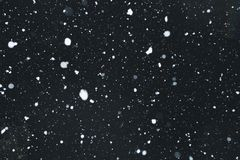 Snowing with snowflakes on black background. Snowing with snowflakes particles on black background stock photography