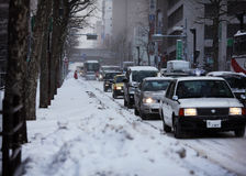 Snowing street traffic in gloomy winter Royalty Free Stock Photos