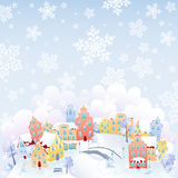 Snowing town. Cute winter town on the top of the hill in snowfall. Snowflakes in separate layer