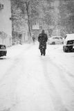 Snowing urban landscape with people Stock Image