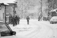 Snowing urban landscape with people Royalty Free Stock Photography