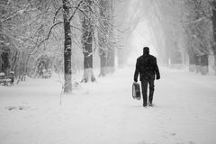 Snowing urban landscape with people Stock Photo