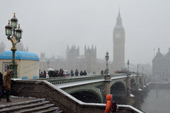 Snowing on Westminster Bridge. London, UK - Westminster Bridge: January 20, 2013. Londoners and tourists brave freezing temperatures, snowfalls and blizzards Royalty Free Stock Photography