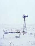 Snowing on Windmill. Windmill being snowed upon with water tanks Royalty Free Stock Image
