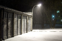 Snowing in winter night. Under lantern Stock Photos