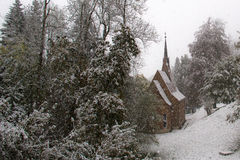 Snowing in winter. In the village Royalty Free Stock Images