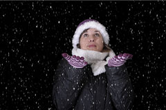 Snowing on young woman in wiinterclothes Stock Images