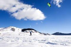 Snowkiter Enjoying His Ride Royalty Free Stock Image