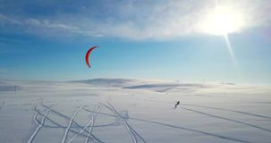 Snowkiting in the north. Filmed by drone stock video