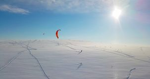 Snowkiting in the North. Filmed by Drone stock footage