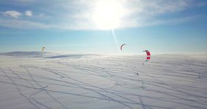 Snowkiting in the North. Filmed by Drone stock video footage