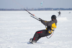 Snowkiting on a snowboard. On a frozen lake Royalty Free Stock Photo