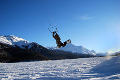 Snowkiting in St.Moritz. Flying over Engadina lake, Switzerland stock photography