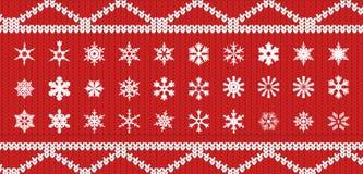 Snowlakes stabiliti su struttura tricottata di colore rosso con un modello bianco nella forma illustrazione vettoriale
