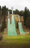 Snowless ski slope. An empty ski slope without any snow Stock Image