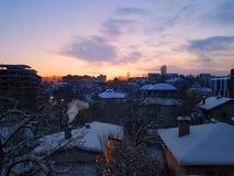 Snowly en soluppgång Royaltyfri Foto