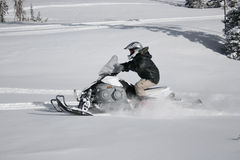 Snowmachine or snowmobile rider 1. A snowmachine or snowmobile rider on fresh powder,snowcat,skimobile royalty free stock image