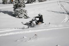 Snowmachine or snowmobile rider 2. A snowmachine or snowmobile rider on fresh powder Royalty Free Stock Photos