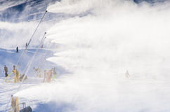 Snowmakers blowing fresh snow Royalty Free Stock Photos
