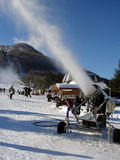 Snowmaking machine in action. On sunny winter day by Hunter Mountain Ski Resort, NY royalty free stock image