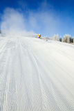 Snowmaking on a mountain ski resort Stock Image