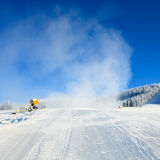 Snowmaking on a mountain ski resort Royalty Free Stock Photography