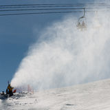 Snowmaking spraying snow Royalty Free Stock Photos