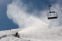 Snowmaking spraying snow Royalty Free Stock Photo