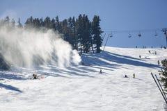 Snowmaking spraying snow Stock Image