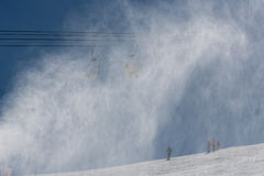 Snowmaking spraying snow Stock Photography