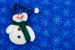 Snowman. A snowman on a snowflake background, snowman Stock Images