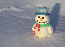 Snowman. Little christmas snowman on the snow white background Stock Images