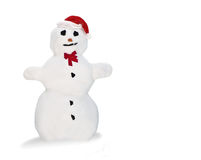 Snowman. Isolated happy snowman (real snow) with santa hat on white background Stock Photo