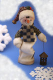 Snowman. With snowflakes on blue background Royalty Free Stock Photos