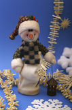 Snowman. With snowflakes on blue background Stock Image