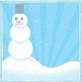 Snowman. A snowman with a hat and carrot nose Stock Photography