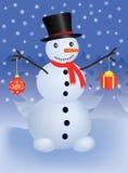 Snowman. With christmas ball and gift Stock Photos