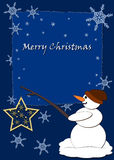 Snowman. Christmas card - snowman in snow with star in winter Royalty Free Stock Images