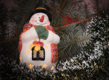 Snowman. Glowing Snowman on Christmas Lights Stock Photo