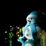 Snowman. Snowman and Christmas ball with black background Stock Photography