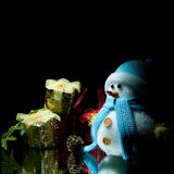 Snowman. Snowman and gift box with black background Royalty Free Stock Image