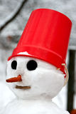 A snowman. With a red pail on his head Royalty Free Stock Photography