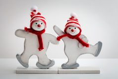 Snowman. Two snowman decorations onbright  white background Royalty Free Stock Image