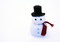 Snowman. Cute little snowman wearing a top hat and a red scarf Royalty Free Stock Images