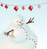Snowman. Snow man with red heart-shaped lanterns Stock Images