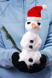 Snowman. Girl holding snowman on hands Stock Images