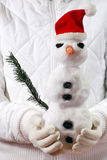 Snowman. Girl holding snowman on hands Royalty Free Stock Photography