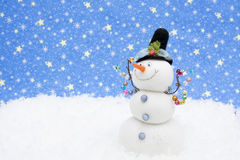 Snowman. Happy Snowman on snow with night sky background Royalty Free Stock Photography