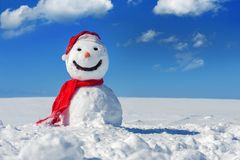 Snowman. On blue sky background Stock Photography