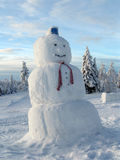 Snowman. Who stands among the snow-covered trees in Finnish Lapland royalty free stock image